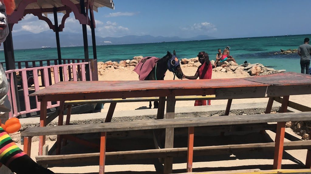 Tips on visiting Hellshire Beach Jamaica. A vibrant beach near Kingston Jamaica full of culture. Best place for seafood, namely fish and festival on this side of the island. Hellshire is in Portmore, St. Catherine Jamaica. Enjoy this local favorites with tips on visiting from Jamaican Dawta