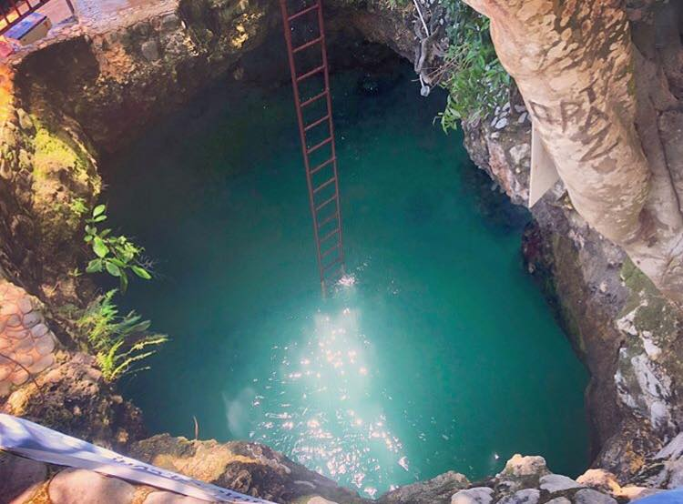 the climb down into Blue Hole Mineral Spring